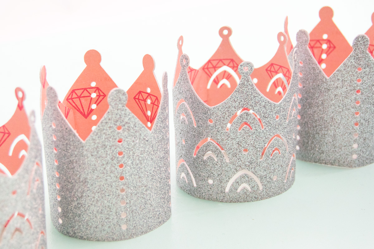 Create the perfect princess party crowns by using glitter cardstock and coordinating patterned paper. Get all the details on the blog. #princessparty #princesspartyideas #diypapercrown #cricut #cricutmade