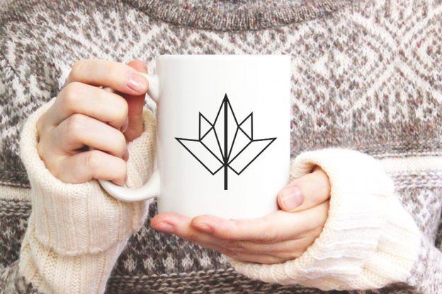 woman holding fall mug