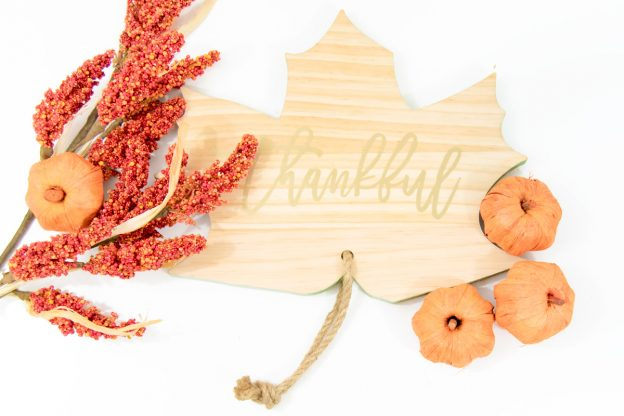 wooden leaf with gold thankful words on it