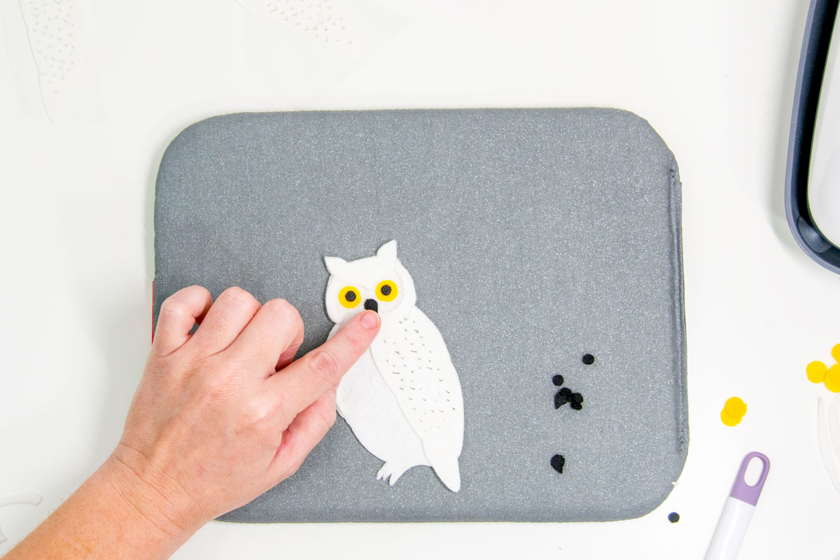 gluing the beak to a felt owl