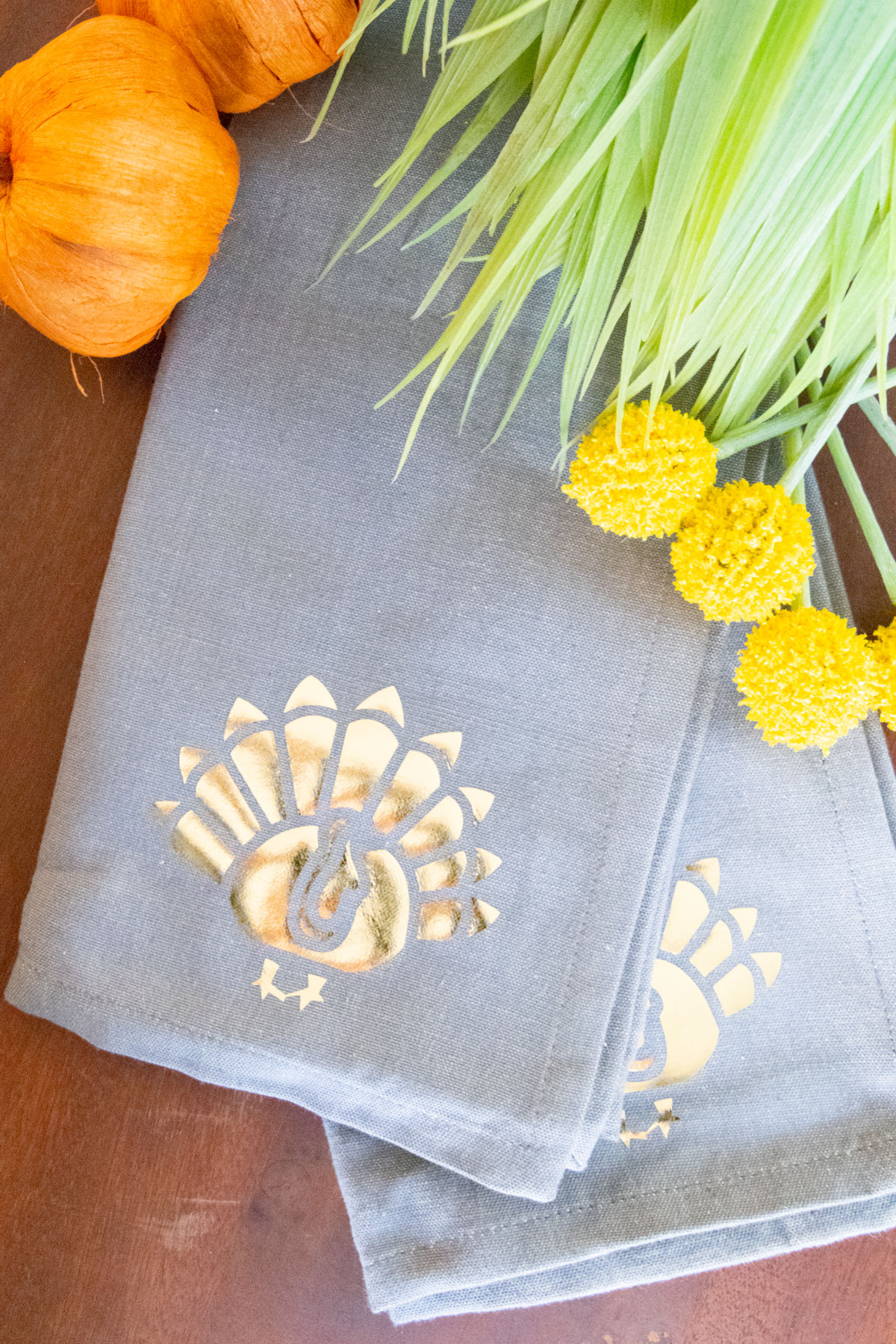 gold foil turkey on grey napkin