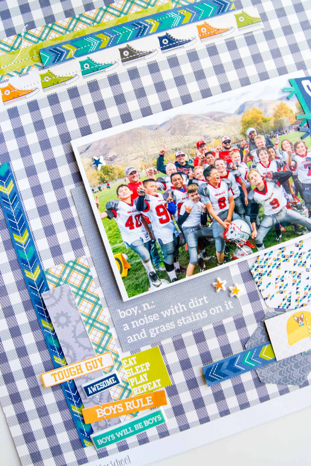 yellow and blue scrapbook paper with football team picture