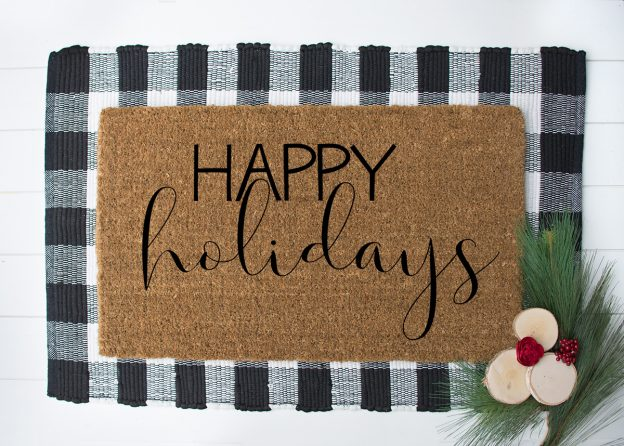 DIY doormat for Christmas that says Happy Holidays
