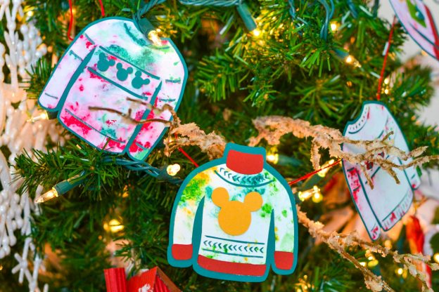paper ugly sweater hanging on tree