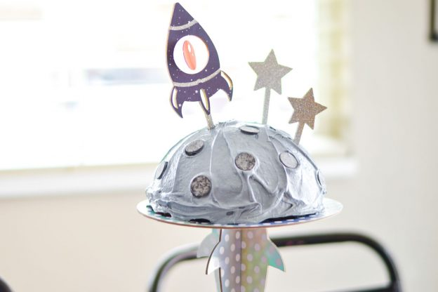 spaceship cricut cake topper on moon cake