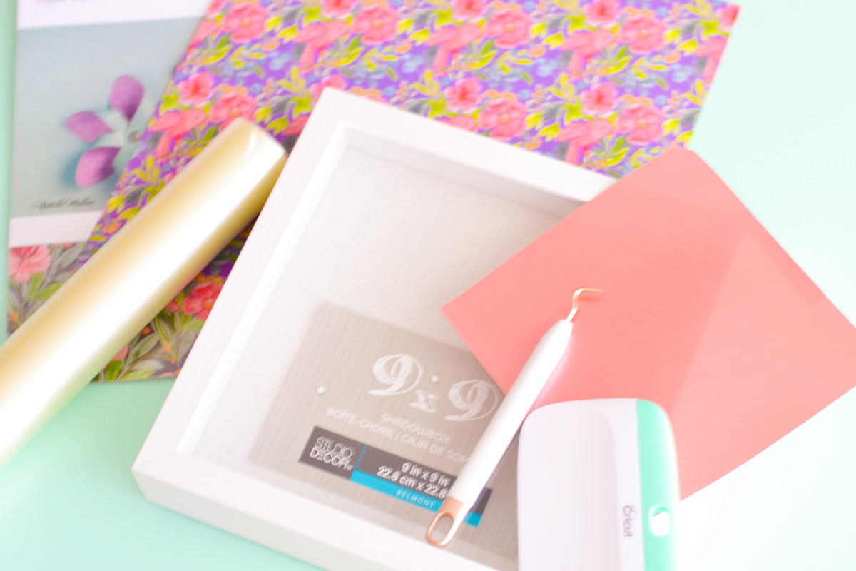 Create the perfect Mothers Day gift for that special Grandma in your life. Learn how easy it is to make a Mother's Day Shadow Box using your Cricut and some rose gold vinyl. Win a Cricut for you and your mom and start creating Cricut crafts ASAP! #cricut #cricutmade #mothersdaygift #mothersday #shadowbox #cricutshadowbox #grandmothergift