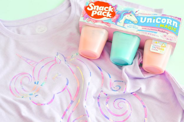 Make the coolest unicorn shirt using this free unicorn SVG file that can be cut on your Silhouette or Cricut machine. Use your Cricut EasyPress to adhere the holographic HTV and enjoy your unicorn Snack Packs as you rock your awesome unicorn shirt. #unicornsvg #unicornshirt #cricutmade #silhouettecameo #freesvgfile #unicorncraft #kidsshirt #diytshirt