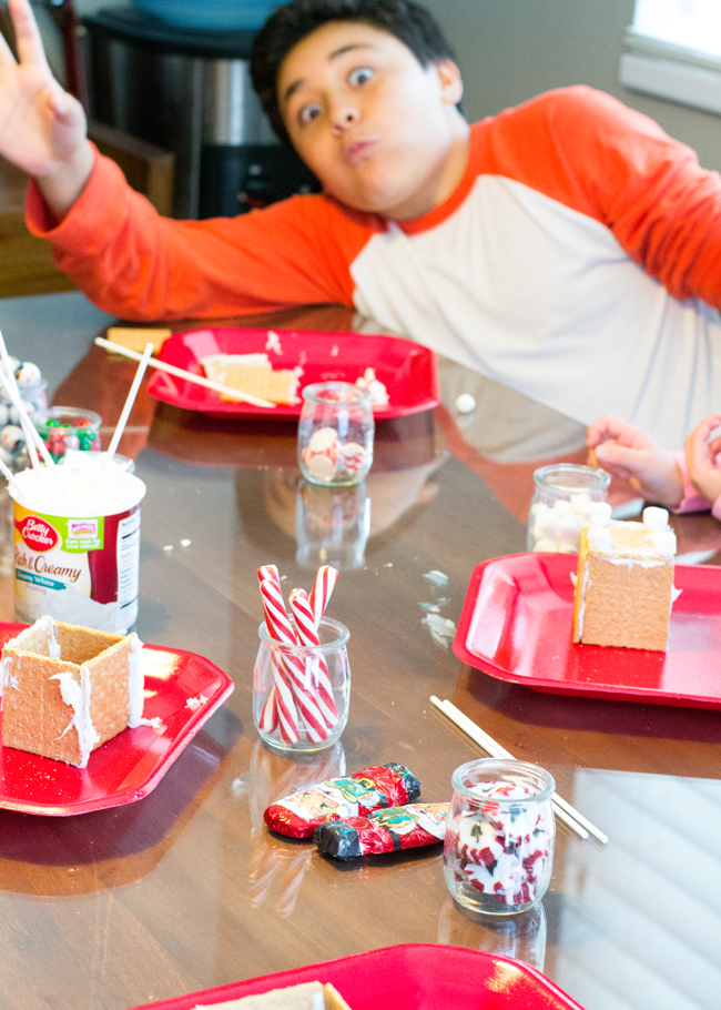 Have a fun Holiday Party making mini gingerbread houses with Honey Maid Graham Crackers