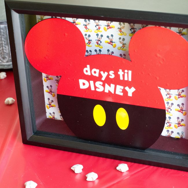 Create your own Disney vacation countdown using a shadow box frame and vinyl.