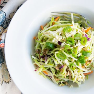 This amazing Broccoli Slaw Salad with crunchy ramen noodles is a must-have at your next barbeque. Create this easy salad in less than 10 minutes and you have a recipe that will stand the test of time. #summersalad #broccolislawsalad #broccolislawsaladrecipe #bbqsalad #sidesalad #potlucksalad