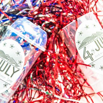 Create a fast and easy Fourth of July craft by using labels, streamers and treat holders.