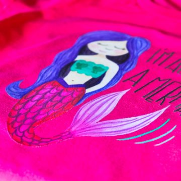 Make this DIY Mermaid shirt using Cricut's new Iron On Designs. Use a household iron or EasyPress to adhere. The easiest way to do Iron On. #Cricut #CricutMade #CricutEasyPress