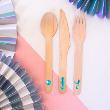 Create personalized wood cutlery using your Cricut and some vinyl. This mermaid cutlery is perfect for your next mermaid party. #mermaid #cricut #craftlightning #cricut #cricutmade #mermaidparty