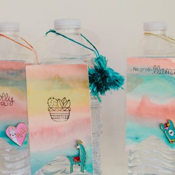 Make the most adorable water bottle tags and include a llama pin party favor. #llamaparty #cricutmade #newtonsnook #xyron