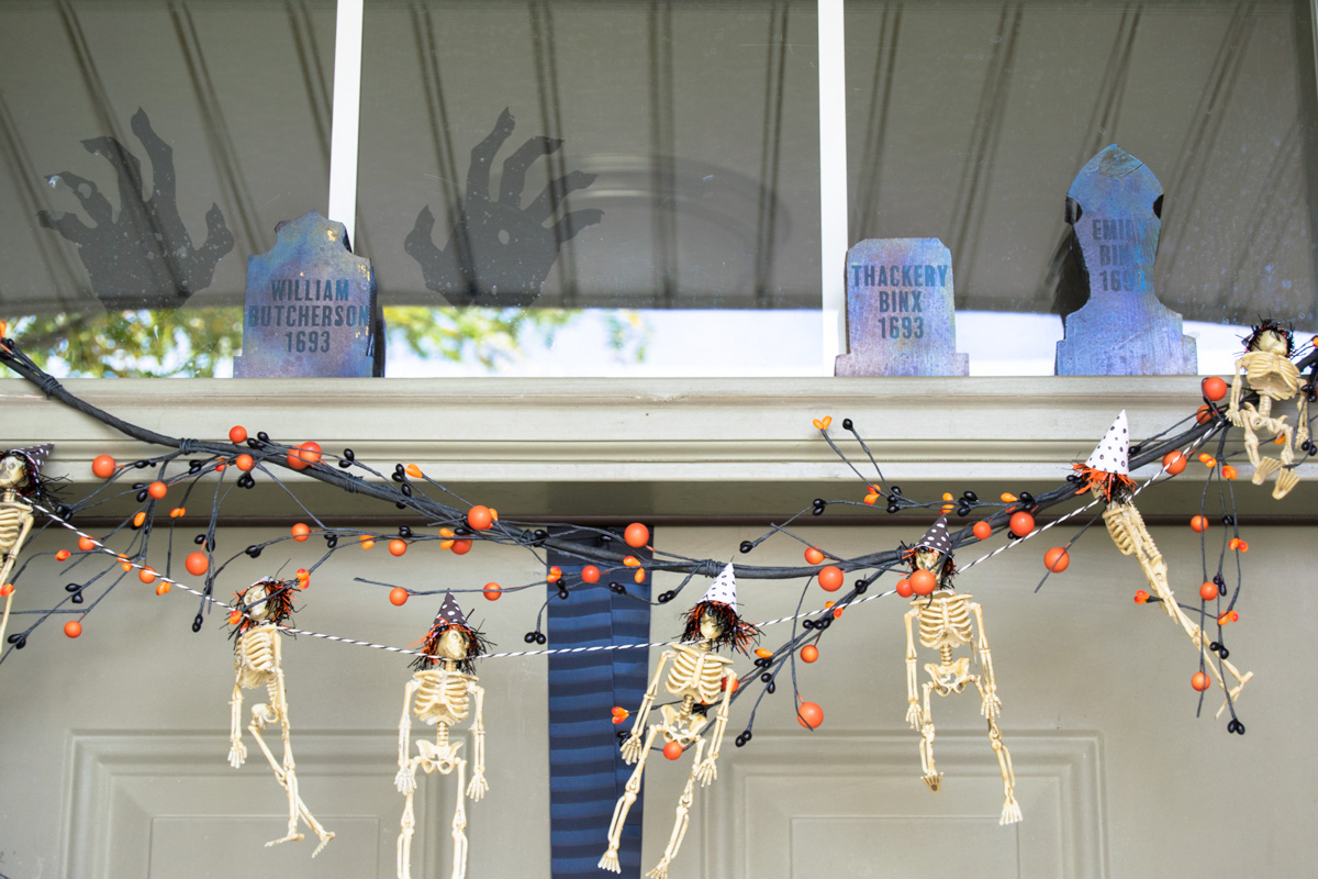 hocus pocus tombstone with skeleton garland