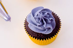 PURPLE BUTTERCREAM ON A CHOCOLATE CUPCAKE