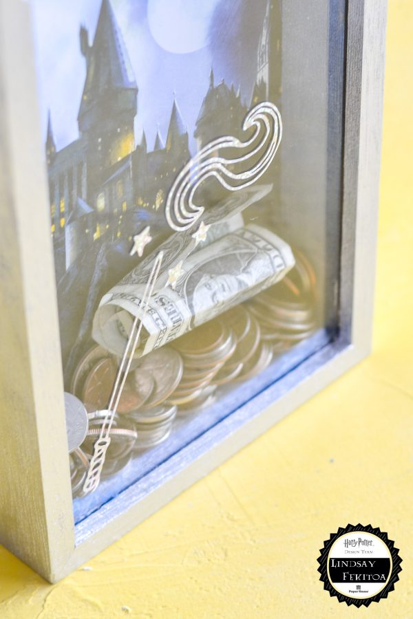 wizard wand cut out of vinyl on money bank
