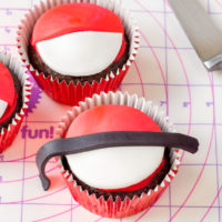 make a poke ball cupcake