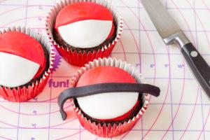 make a poke ball cupcake