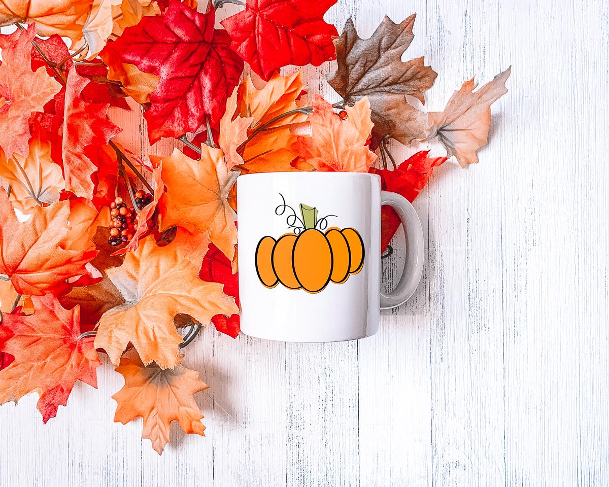 fall pumpkin on a coffee mug