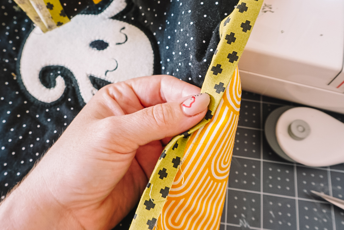 folding binding tape on quilt