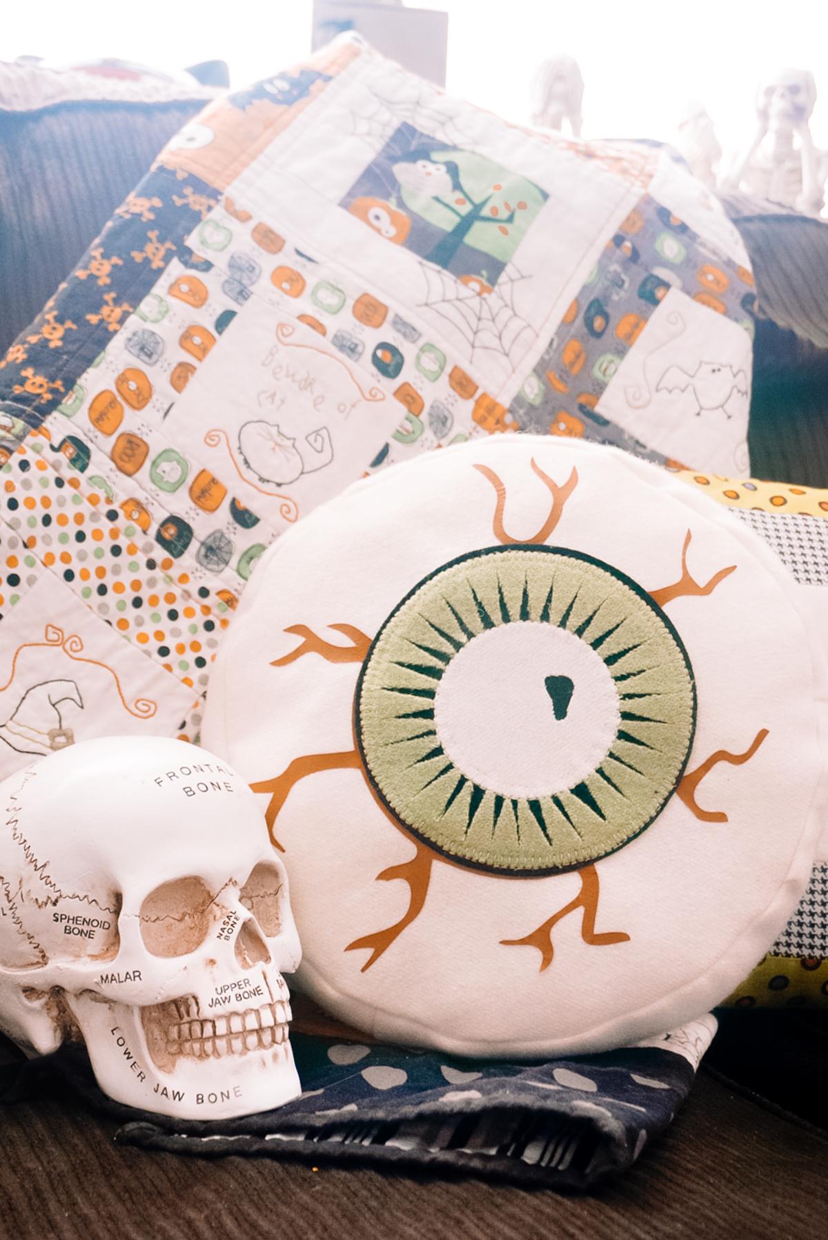 handmade halloween pillow in the shape of an eye