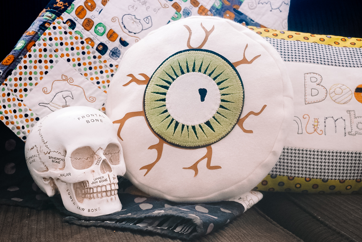 eyeball pillow on couch with skull