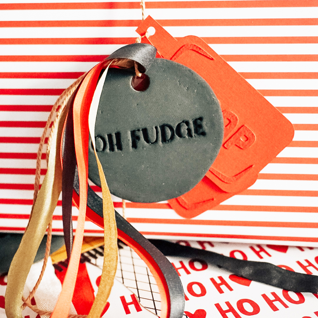 paper soap gift tag with a clay ornament that says oh fudge