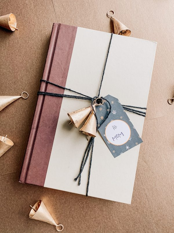 hygge style wrapped book with free printable christmas tags