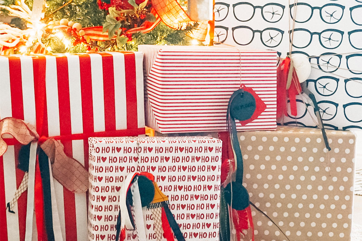 grouping of present wrapped in personalized a christmas story wrapping paper