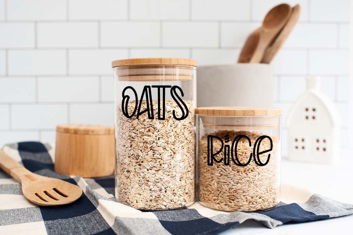 jars on counter filled with oats and rice with labels