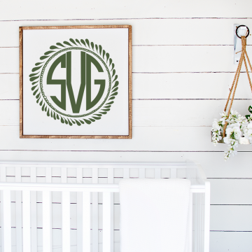 monogram above a white crib