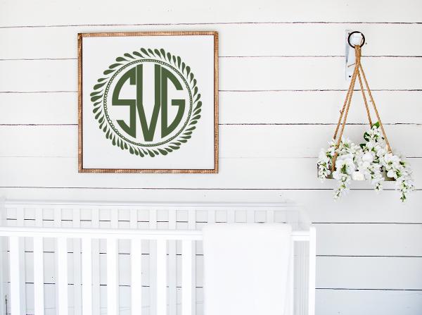monogram above a white crib