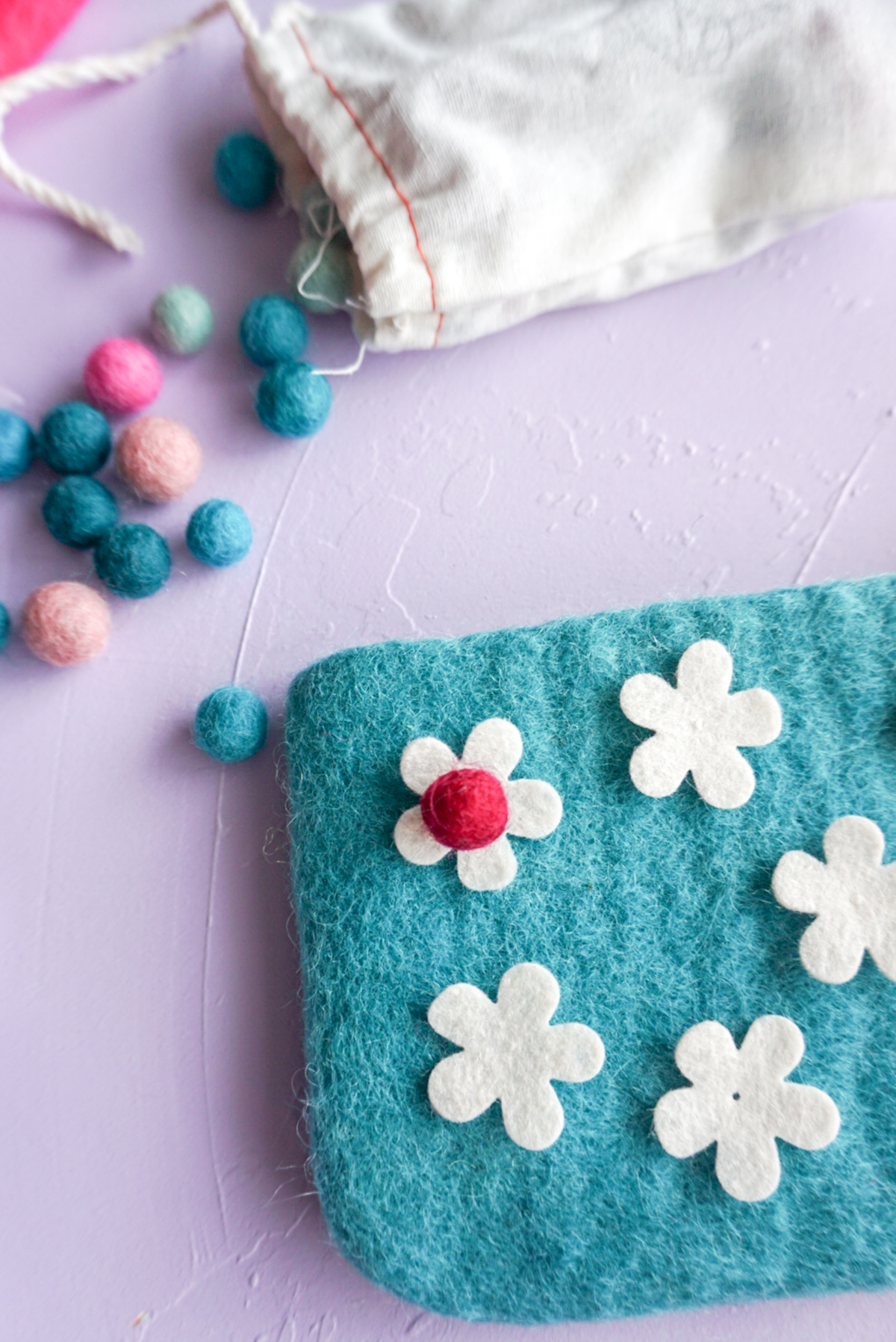 felt flowers on a felt pouch